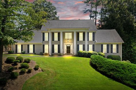 beautiful white painted brick home for sale in roswell ga