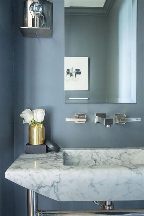 gold  blue powder room boasts slate blue paint  walls