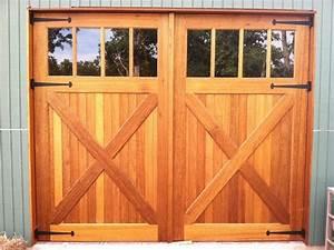 Wood garage doors and carriage doors rustic garage for Carriage style garage doors for sale