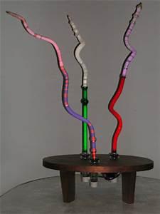 wood sculpture bases neon sculpture neon art
