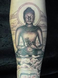a meditating buddha statue arm tattoo | BUDDHA TATTOO ...