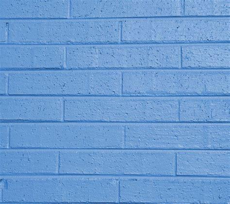 light blue painted brick wall background wallpaper