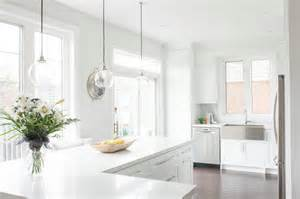 white l shaped kitchen with island caesarstone calacatta nuvo countertops design ideas