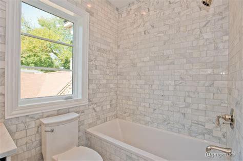 marble subway tile bathroom calcutta gold marble design ideas