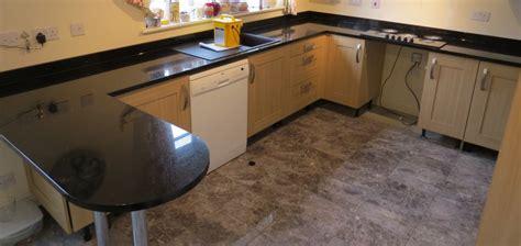 galaxy granite kitchen countertop with breakfast bar