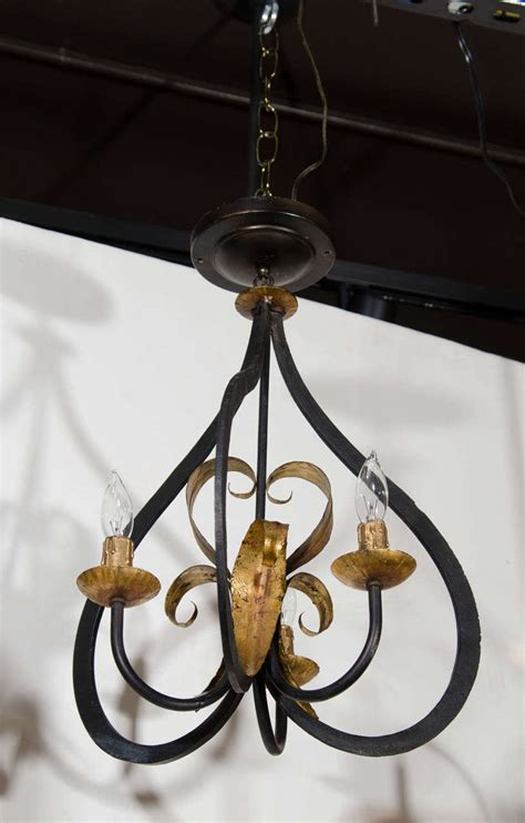 fleur de lis chandelier with stylized latern form