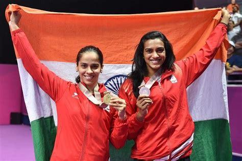 cwg  saina nehwal beats p  sindhu  win gold