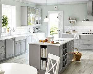 White appliances, white counters, light grey cabinets http