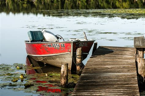 Old Boat Dock by Old Lund Boat At Dock Photograph By Toni Thomas