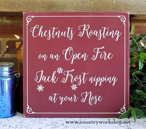 christmas sign chestnuts roasting jack frost nipping wood