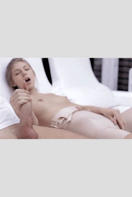 Hot blonde strokes a big cock while playing with... - HandyFan