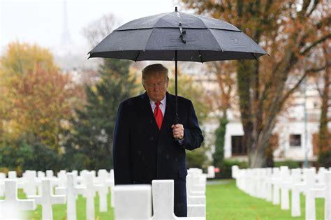 trump donald cemetery arlington president kim un jong letters veterans ceremony armistice hair wet american paris he europe soldiers ww1