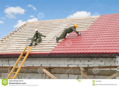 roofing work with metal tile stock photography image