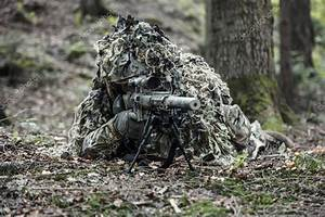 sniper wearing ghillie suit — Stock Photo © zabelin #129275346