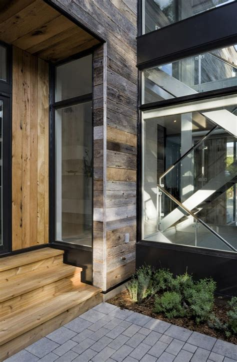 opposites attract   rustic wood clad house