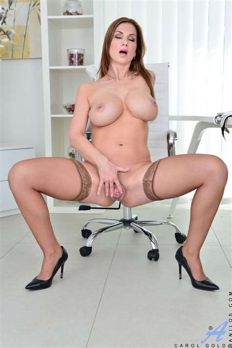 busty erotic mature undressing and masturbating bald snatch close up in office