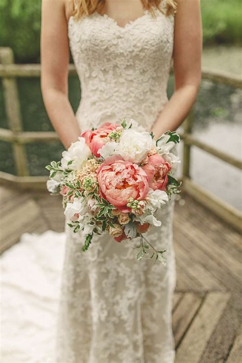 gorgeous relaxed rustic coral peony filled barn wedding