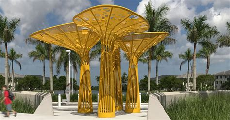 this yellow tree like sculpture brings color to a plaza in