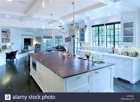 open floor plans with large kitchens wooden topped island unit in large open plan kitchen 8995