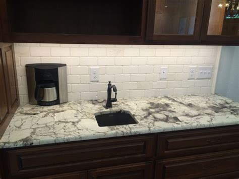 white travertine kitchen backsplash  koehn tile el