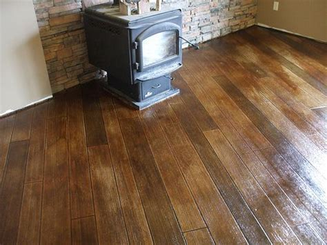 stained/stamped concrete to look like wood floors.   House