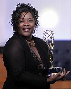 Actress Loretta Devine holds with her Outstanding Guest ...