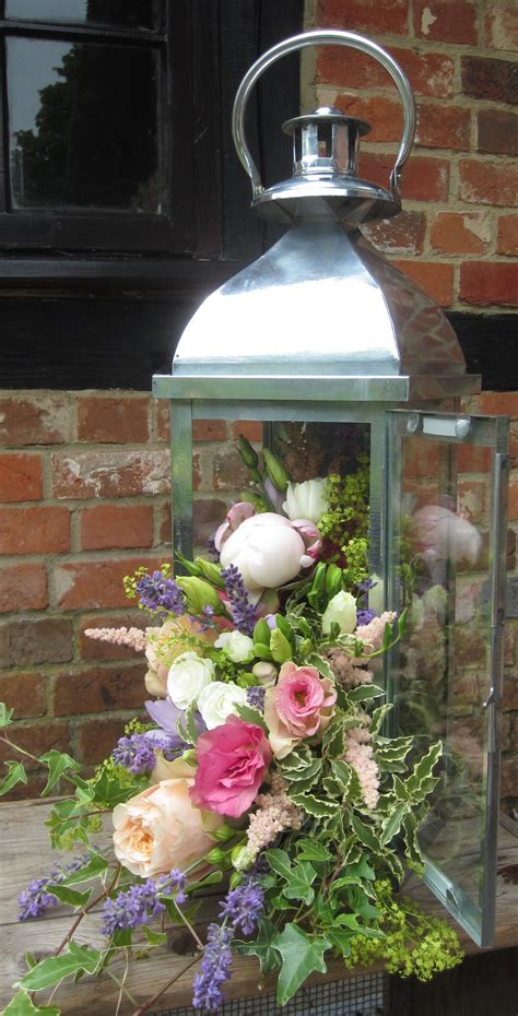 Lantern with cascading flowers including pale pink peony