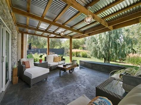 corrugated iron roof with exposed beams pergola