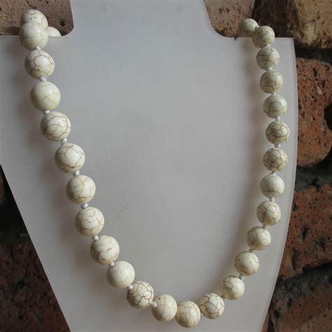 White Howlite Gemstone Round Bead Necklace  Knotted. Jade Diamond. Brown Rings. 14k Gold Chains. Vancaro Wedding Rings. Glitter Earrings. Cremation Pendant. Orange Earrings. Crown Diamond