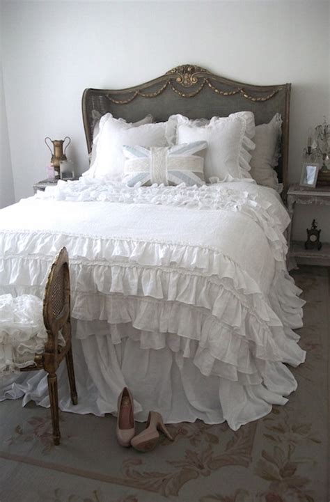 white ruffle comforter gray wingback headboard bedroom