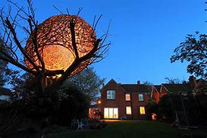 An illuminated woven willow tree house by tom hare colossal for An illuminated woven willow tree house by tom hare