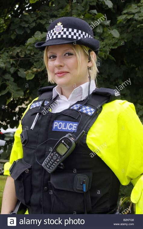 Blonde Female Dorset Policewoman Wearing A Stab Vest On Top Of A Hi Stock Photo Royalty Free