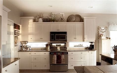 decorate space above kitchen cabinets decorating tops of kitchen cabinets fill in space above 8570