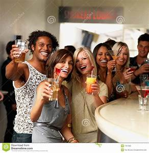 Stock Photos: Happy young friends saying cheers at a bar ...