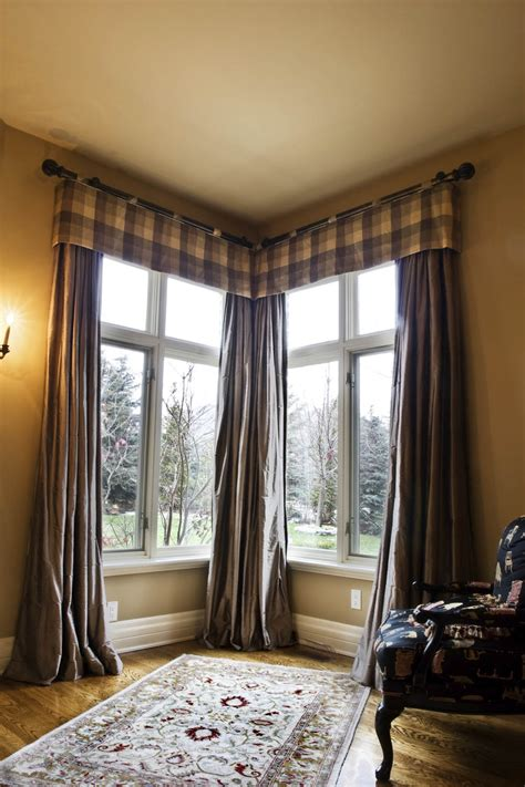 shed style corner windows with masculine window treatment interior
