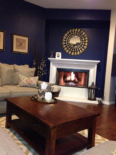 Blue Living Room Accents by Navy Blue Walls Gold Accents And A White Fireplace