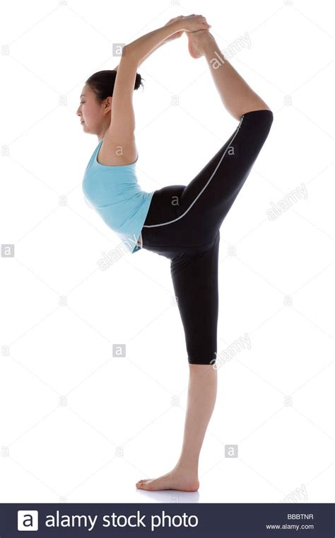 Female Gymnast Standing On One Leg Holding Other Foot
