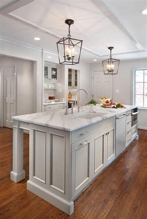 long light gray center island  sink  dishwasher