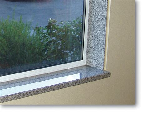 Interior Window Sill Design by Bathtub Window Wrapped In Solid Surface Tiling