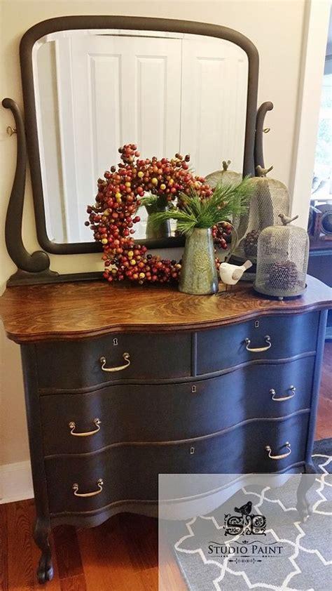 shapely serpentine painted antique dresser