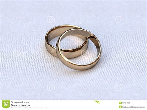 couple of gold wedding rings on white background royalty