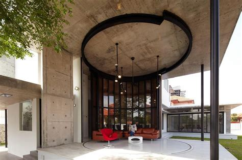 curved  stacking louvered glass doors surround room