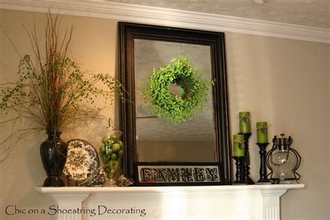 decorating a fireplace mantle fireplace mantel decor how to decorate the fireplace chic on a shoestring decorating adding pops of