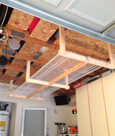 overhead garage storage systems diy overhead garage storage rack four 2x3 39 s and two 8