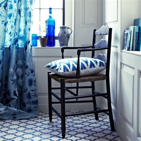 blue and white bathroom with graphic floor tiles and