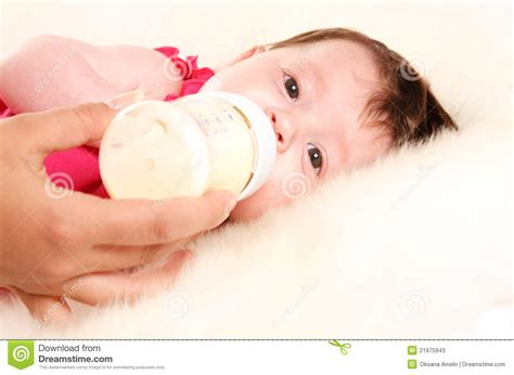 Baby Girl Drinking Milk From Bottle Stock Photos Image