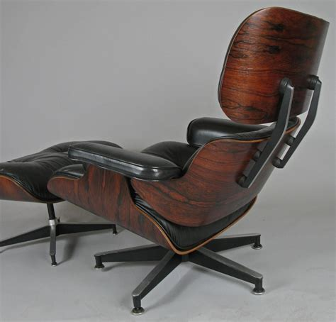 vintage rosewood and leather eames lounge chair and