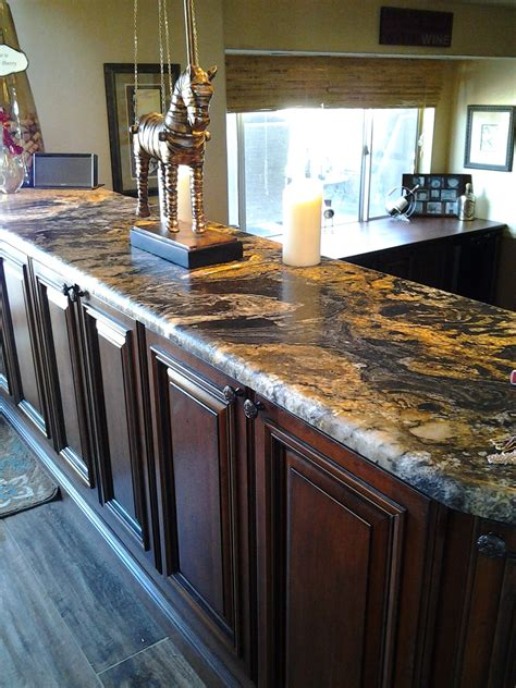 volcano granite  gingersnap cabinets