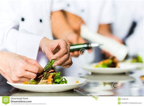 chefs cuisine chef in restaurant kitchen cooking stock photo image of