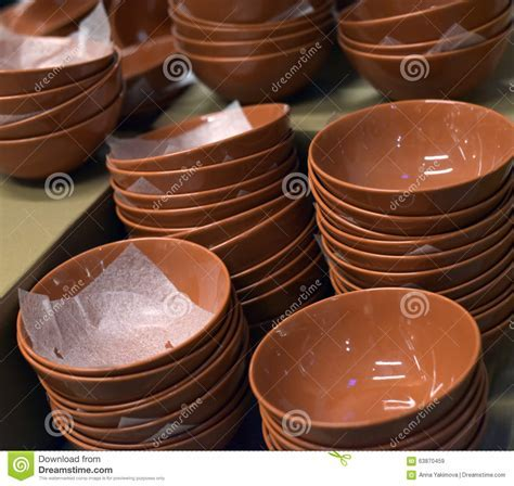 Brown Ceramic Plates Stacked Stock Photo   Image: 63870459
